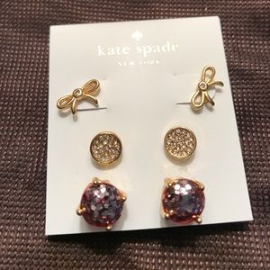 Kate Spade warring trio.